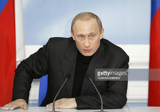 Russian President Vladimir Putin speaks to the press at his campaign headquarters near the Kremlin early 15 March 2004 in Moscow Putin stormed to a...
