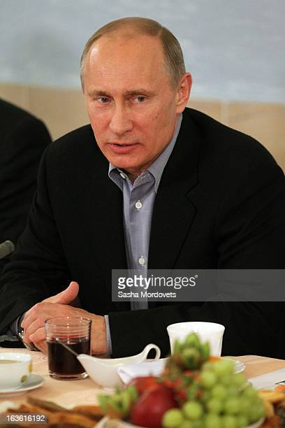 Russian President Vladimir Putin speaks while visiting Sambo70 a Russian martial art and combat sport school March 13 2013 in Moscow Russia Putin and...
