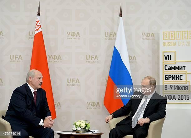 Russian President Vladimir Putin speaks with Belarusian President Alexander Lukashenko during their meeting in Ufa, the capital of Bashkortostan...