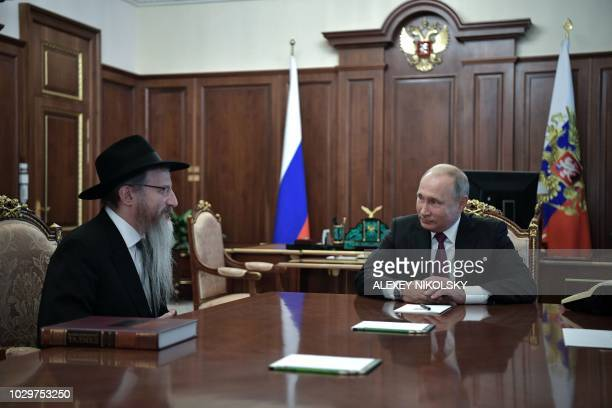 Russian President Vladimir Putin speaks with Chief Rabbi of Russia Berel Lazar during their meeting in connection with celebration of the Jewish New...