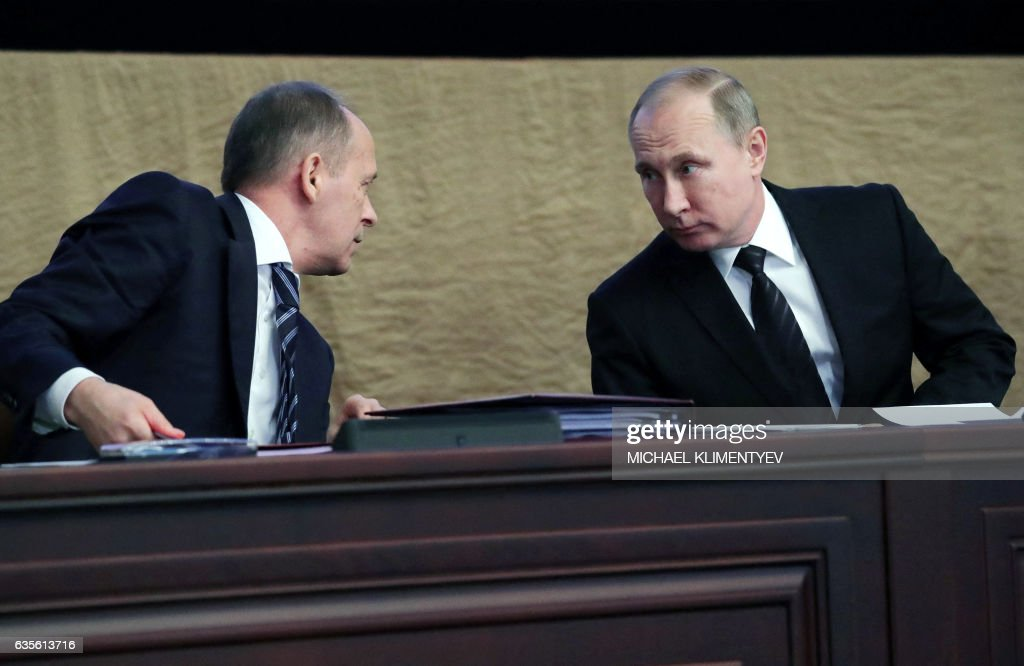Russian President Vladimir Putin (R) speaks with Director of the Federal Security Service (FSB) Alexander Bortnikov (L) during a meeting of the Federal Security Service's board in Moscow on February 16, 2017. Putin on February 16 called for Russian intelligence agencies to bolster ties with their US counterparts in the fight against terrorism. / AFP / Sputnik / Michael Klimentyev