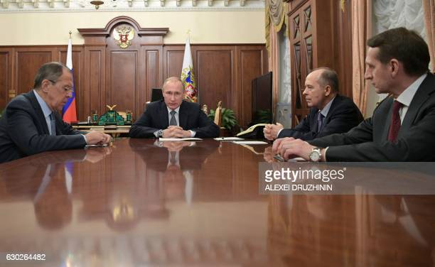 TOPSHOT Russian President Vladimir Putin speaks with Foreign Minister Sergei Lavrov director of the Foreign Intelligence Service Sergei Naryshkin and...