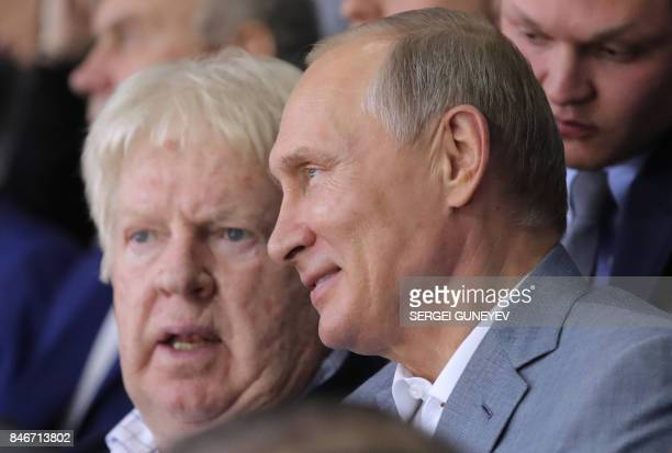 Russian President Vladimir Putin speaks with former Canadian hockey player Pat Stapleton participant of the legendary 1972 CanadaUSSR ice hockey...