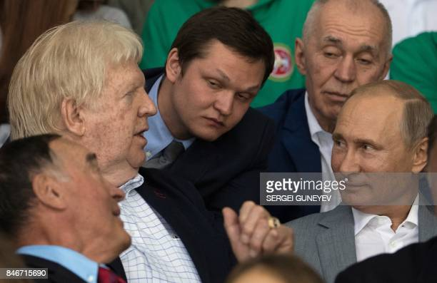 Russian President Vladimir Putin speaks with former Canadian hockey players Pete Mahovlich and Pat Stapleton participants of the legendary 1972...