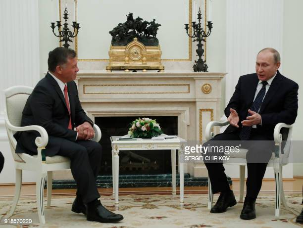 Russian President Vladimir Putin speaks with King Abdullah II of Jordan during their meeting at the Kremlin in Moscow on February 15 2018 / AFP PHOTO...