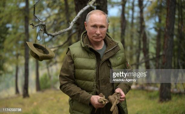 Russian President Vladimir Putin spends time in the Siberian Taiga forest to take a break from state affairs ahead of his birthday in Siberia Russia...