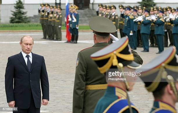 Russian President Vladimir Putin stands as he participates in the Parade of the Presidential Regiment May 7, 2006 in Moscow, Russia. The Presidential...