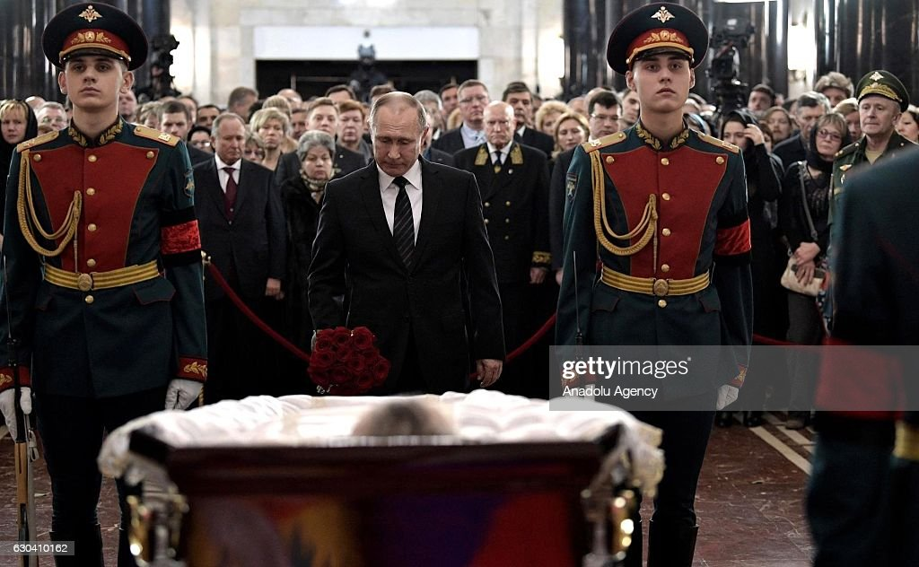 Russian President Vladimir Putin, stands behind the coffin during funeral service for Russia's ambassador to Turkey Andrey Karlov, in Christ the Savior Cathedral in Moscow, Russia, on December 22, 2016. Karlov was delivering a speech at the opening ceremony of a photo exhibit when an armed assailant 22-year-old riot police officer Mevlut Mert Altintas opened fire on him. Assailant has been killed by the Turkish police during a fire exchange at the crime scene.