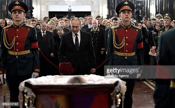 Russian President Vladimir Putin, stands behind the coffin during funeral service for Russia's ambassador to Turkey Andrey Karlov, in Christ the...