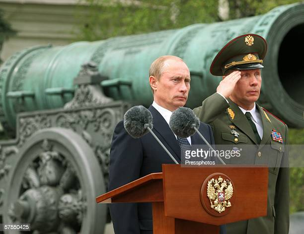 Russian President Vladimir Putin stands near a podium as he participates in the Parade of the Presidential Regiment May 7, 2006 in Moscow, Russia....