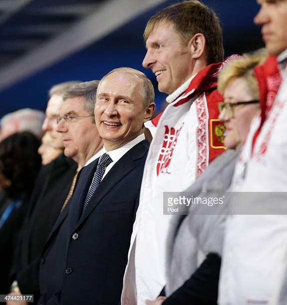 Russian President Vladimir Putin stands next to Alexander Zubkov gold medalist in the twoman and fourman bobsled for Russia during the 2014 Sochi...