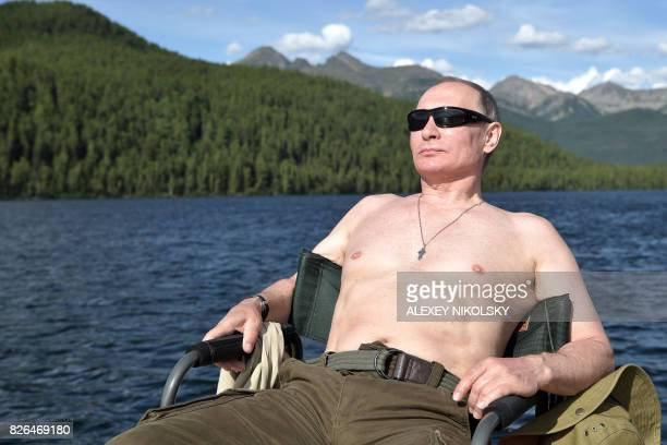 TOPSHOT Russian President Vladimir Putin sunbathes during his vacation in the remote Tuva region in southern Siberia The picture taken between August...
