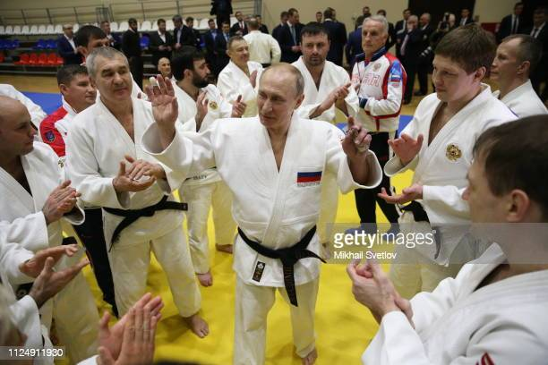 Russian President Vladimir Putin surrounded by national judo team athletes attends training at Yug Sport complex February 14 2019 in Sochi Russia...