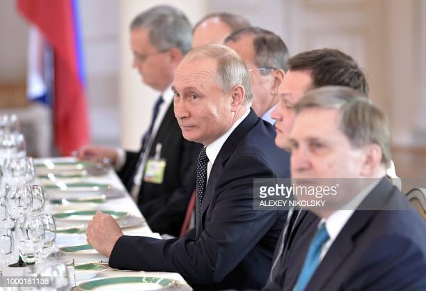 Russian President Vladimir Putin takes part in a working lunch with the US President in Helsinki on July 16 2018 The US and Russian leaders opened an...