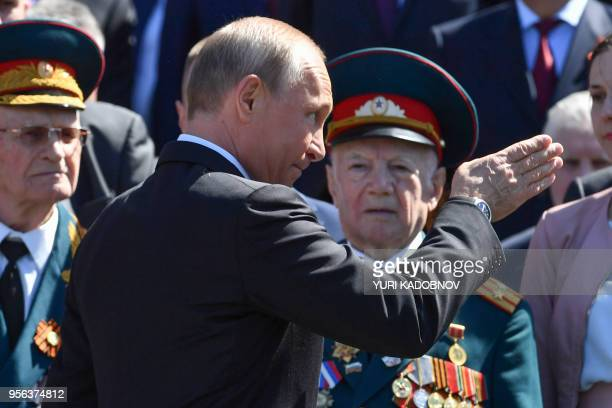 Russian President Vladimir Putin takes part in a wreath laying ceremony marking the 73rd anniversary of the Soviet Union's victory over Nazi Germany...