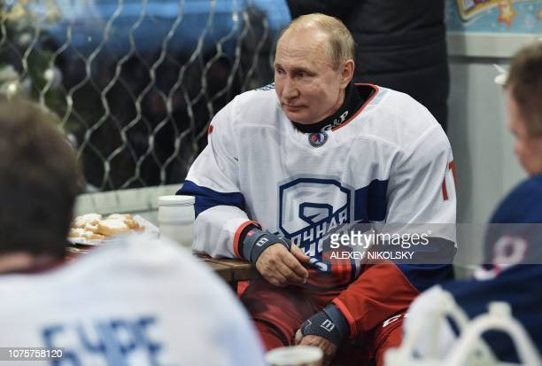 Russian President Vladimir Putin takes part in the Night Hockey League match on the GUM department store skating rink at Red Square in Moscow on...