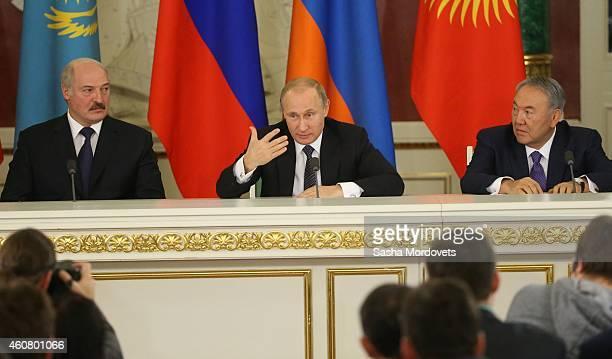 Russian President Vladimir Putin talks as Belarussian President Alexander Lukashenko and Kazakh President Nursiltan Nazarbayev during the Summit of...