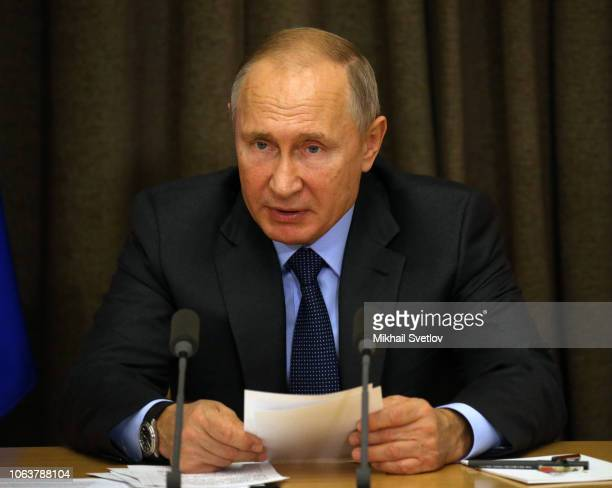 Russian President Vladimir Putin talks during his meeting with Ministry of Defence officials at his Black Sea resort residence in Sochi Russia...