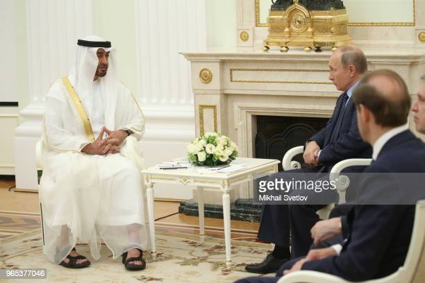 Russian President Vladimir Putin talks to Abu Dhabi's Crown Prince and Deputy Supreme Commander of UAE's Armed Forces Sheikh Mohammed bin Zayed bin...