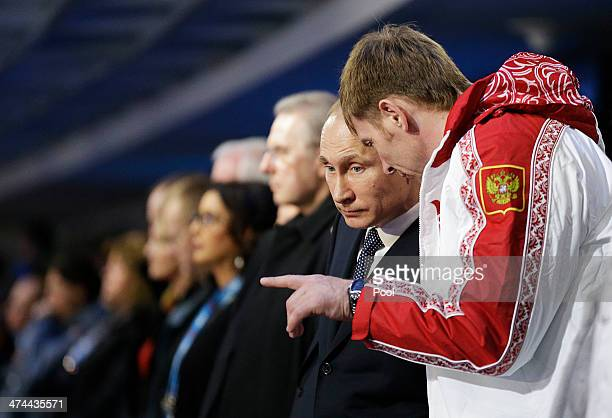 Russian President Vladimir Putin talks to Alexander Zubkov gold medalist in the twoman and fourman bobsled for Russia during the 2014 Sochi Winter...