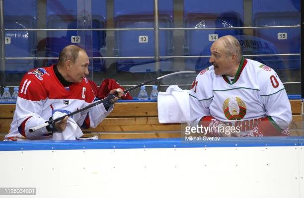 Russian President Vladimir Putin talks to Belarusian President Alexander Lukashenko during an ice hockey match at Shaiba Arena on February 15, 2019...