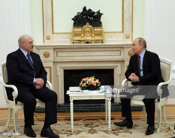 Russian President Vladimir Putin talks to Belarussian President Alexander Lukashenko during their talks at the Kremlin in December 25 2018 in Moscow...