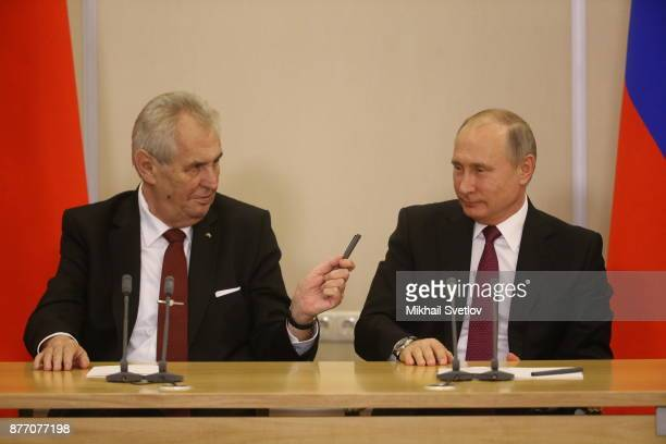 Russian President Vladimir Putin talks to Czech President Milos Zeman during their talks at Black Sea resort state residence of Bocharov ruchey in...