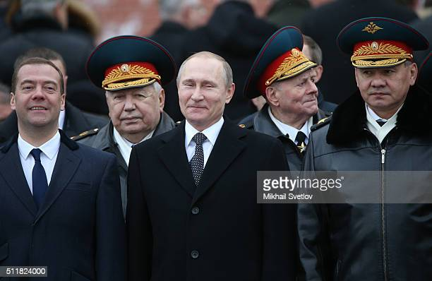 Russian President Vladimir Putin talks to Defence Minister Sergei Shoigu as Presidential Chief of Staff Sergei Ivanov Prime Minister Dmitry Medvedev...