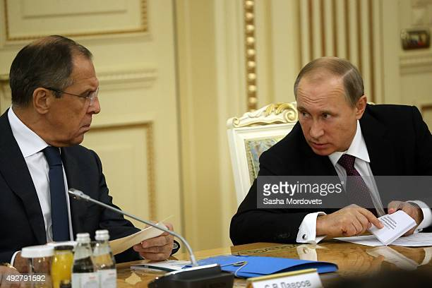 Russian President Vladimir Putin talks to Foreign Minister Sergei Lavrov during the RussianKazakh talks in the Presidential Palace on October 15 2015...