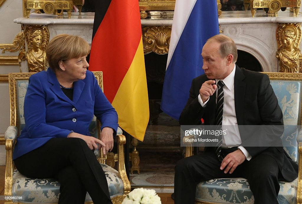 Russian President Vladimir Putin (R) talks to German Chancellor Angela Merkel (L) during their meeting at the Normandy Format Summit on October 02, 2015 in Paris, France. The leaders of France, Germany, Russia and Ukraine are meeting in Paris to consolidate a fragile peace in Ukraine, as a conflict that appears to be winding down is overshadowed by President Vladimir Putin's dramatic intervention in Syria's war.