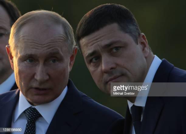 Russian President Vladimir Putin talks to Governor of Pskov Mikhail Vedernikov during the opening ceremony of the monument to Prince Alexander Nevsky...