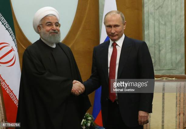Russian President Vladimir Putin talks to Iranian President Hassan Rouhani during their meeting at the Black Sea resort of Sochi on November 22 2017...