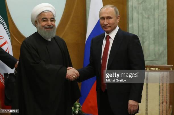 Russian President Vladimir Putin talks to Iranian President Hassan Rouhani during their meeting at the Black Sea resort of Sochi on November 22 2017...