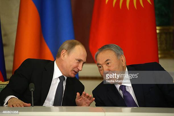 Russian President Vladimir Putin talks to Kazakh President Nursultan Nazarbayev during the Summit of Collective Security Treaty Organisation at the...