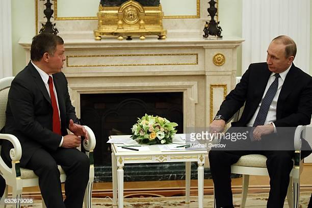 Russian President Vladimir Putin talks to King Abdullah II of Jordan during their meeting at the Kremlin on January 25 2017 in Moscow Russia Abdullah...