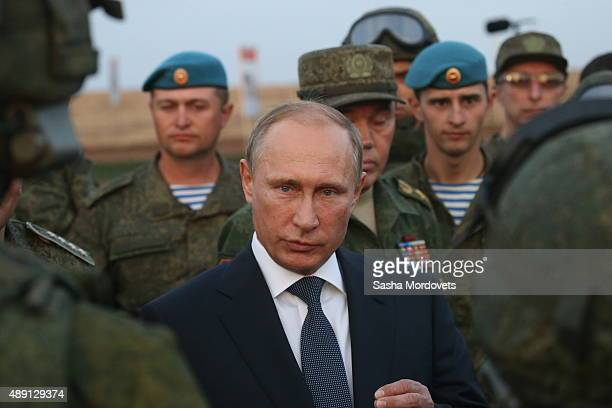 Russian President Vladimir Putin talks to officers as he is visiting the Center -2015 Military Drills at Donguzsky Range in Orenburg, Russia,...