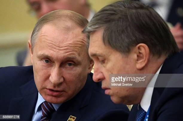 ASTANA KAZAKHSTAN MAY 31 Russian President Vladimir Putin talks to Presidential Aide Yuri Ushakov during the Eurasian Economic Union Summit at Akorda...