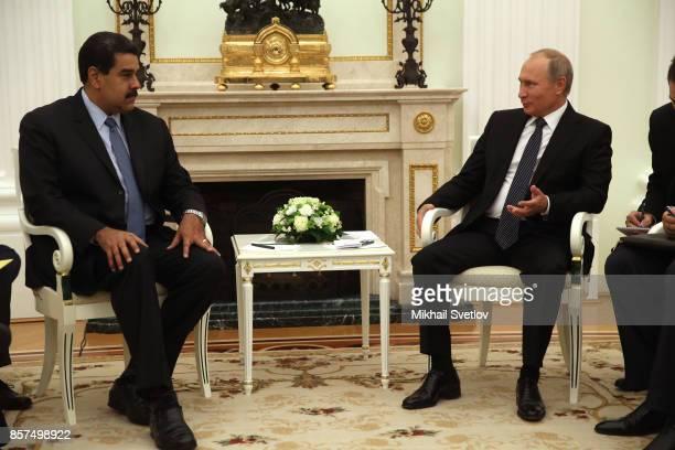 Russian President Vladimir Putin talks Venezuela's President Nicolas Maduro during their meeting at the Kremlin on October 4 2017 in Moscow Russia...