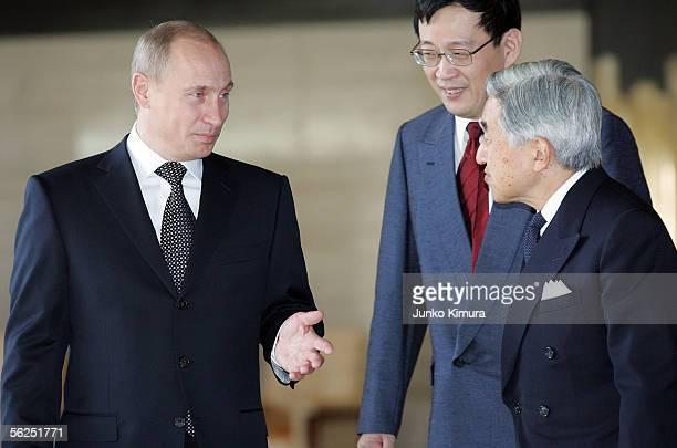 Russian President Vladimir Putin talks with Japanese Emperor Akihito upon his departure at the Imperial Palace on November 22 2005 in Tokyo Japan...