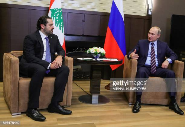 Russian President Vladimir Putin talks with Lebanese Prime Minister Saad Hariri during a meeting in Sochi on September 13 2017 PHOTO / Sputnik /...