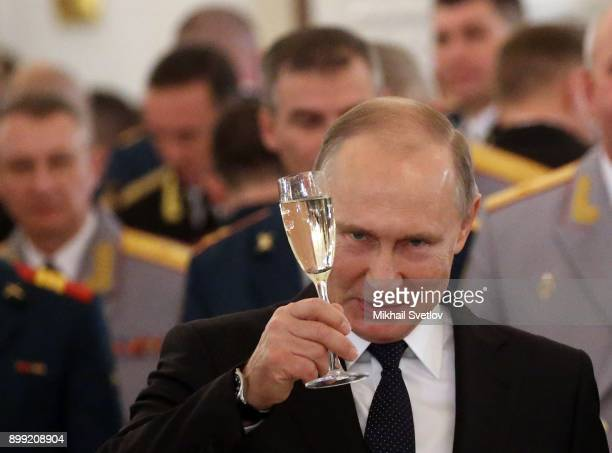 Russian President Vladimir Putin toasts during reception for military servicemen who took part in Syrian campaign at Grand Kremlin Palace on December...