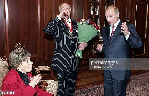 Russian President Vladimir Putin toasts with actors Lidiya Smirnova and Vladimir Zeldin during their meeting at the Kremlin in Moscow 12 February...
