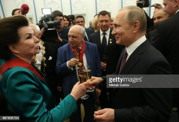 Russian President Vladimir Putin toasts with cosmonaut Valentina Tereshkova during an awards ceremony at the Kremlin in Moscow Russia May2017...