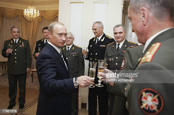 Russian President Vladimir Putin toasts with officers of the State Intelligence Agency at the presidential residence in NovoOgarevo 02 November 2007...
