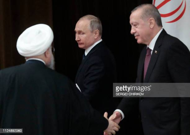 Russian President Vladimir Putin, Turkish President Recep Tayyip Erdogan and Iranian President Hassan Rouhani leave at the end of a joint press...