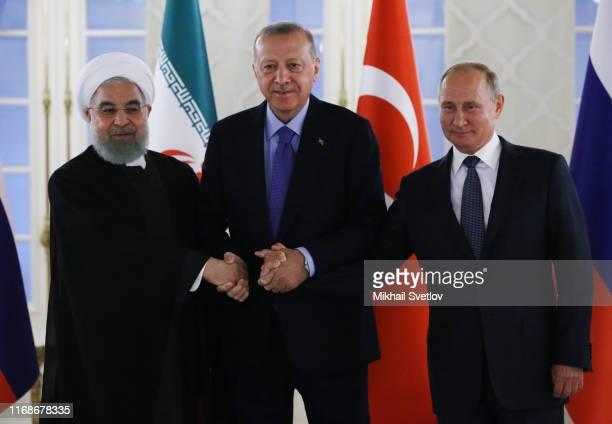 Russian President Vladimir Putin , Turkish President Recep Tayyip Erdogan and Iranian President Hassan Rouhani pose for a photo during their meeting...
