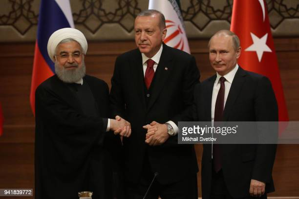 Russian President Vladimir Putin Turkish President Recep Tayyip Erdogan and Iranian President Hassan Rouhani pose for a photo during their meeting at...