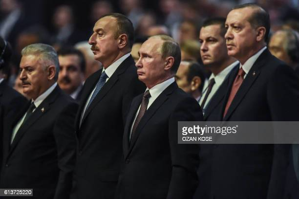 Russian President Vladimir Putin , Turkish President Recep Tayyip Erdogan , Azerbaijan's President Ilham Aliev and Turkish Prime Minister Binali...