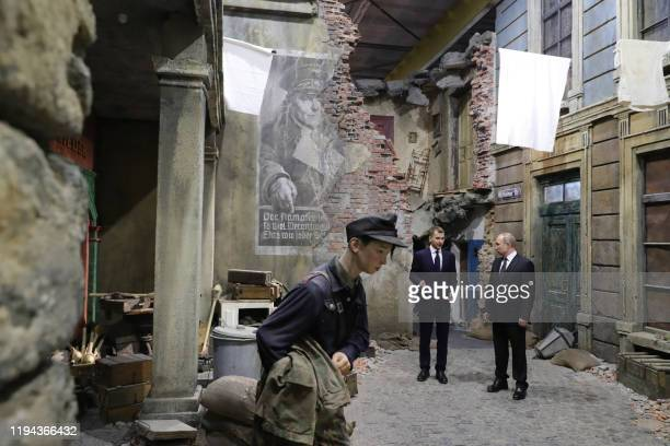 Russian President Vladimir Putin visits a 3D panorama Memory speaks The road through the war in St Petersburg on January 18 as part of the 75th...