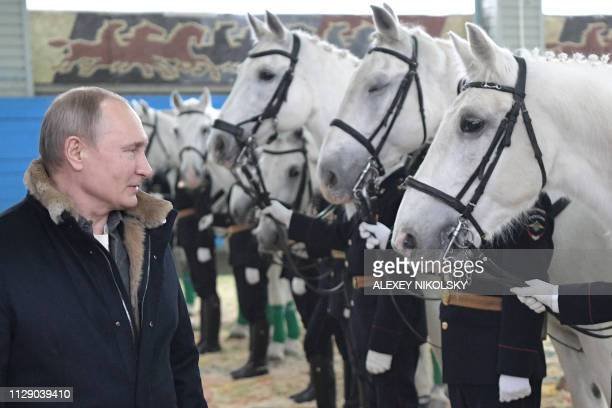 Russian President Vladimir Putin visits a mounted police regiment in Moscow on March 7 2019